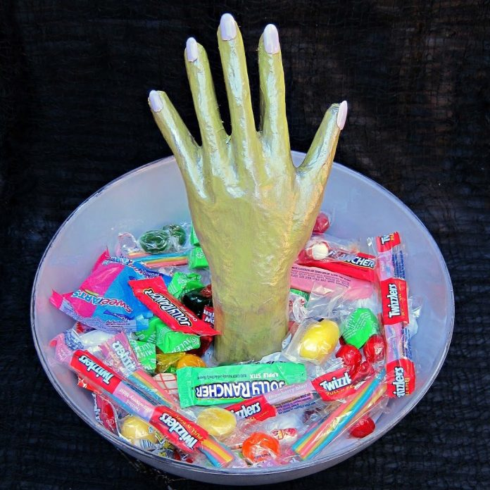 Make your own creepy candy bowl to spook trick or treaters with at Halloween.