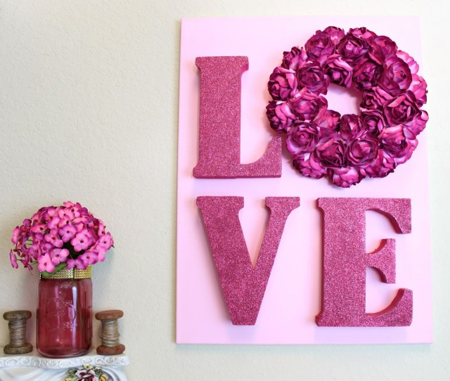 Use unfinished letters and a wreath form to make LOVE letters wall art for Valentine's Day.