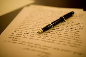 Image of a handwritten letter and a pen. Photo credit: Atlanta Jewish Times
