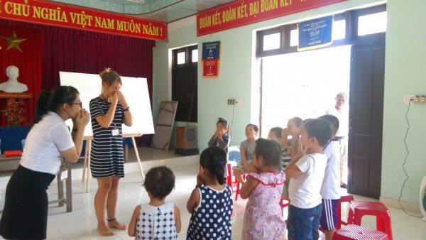 Caitlin teaching kids English in Vietnam