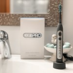 Electric tooth brush sitting on bathroom sink