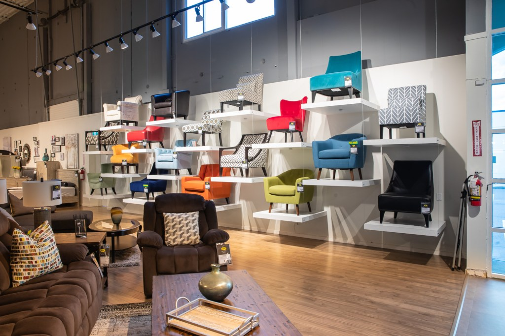 Photo of wall of display chairs at furniture store