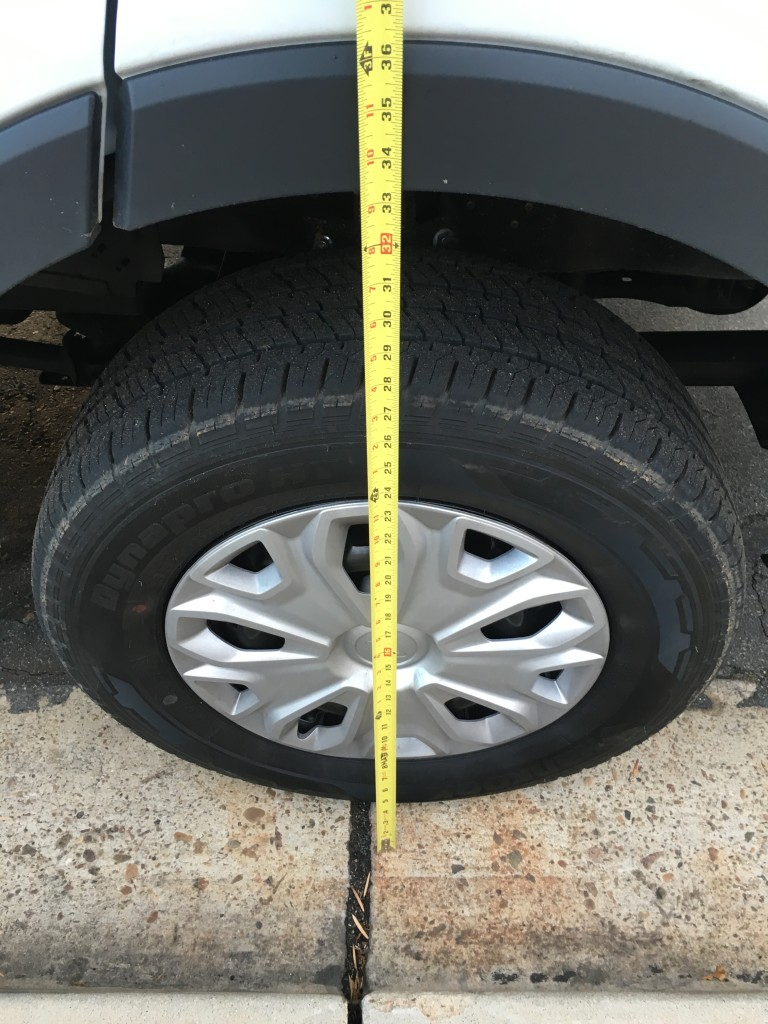 Passenger side front tire. QuadVan adds approximately 2 inches of lift.