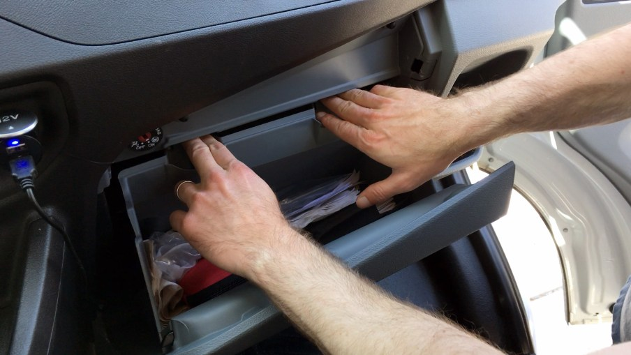 Latches at rear of Glove Box