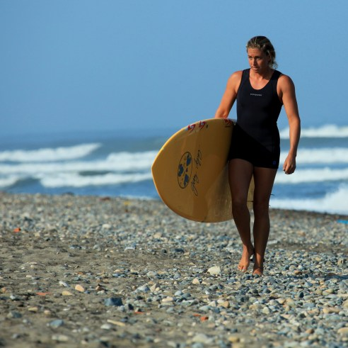 for the record, I am probably much more excited to surf than I look in this photo.  I had just woken up.