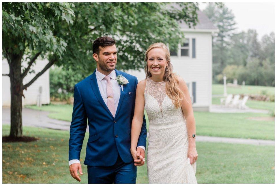 Warren Conference wedding couple walking holding hands