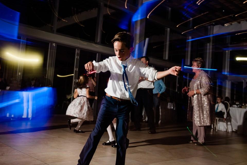 Kid dancing at lake pavilion wedding