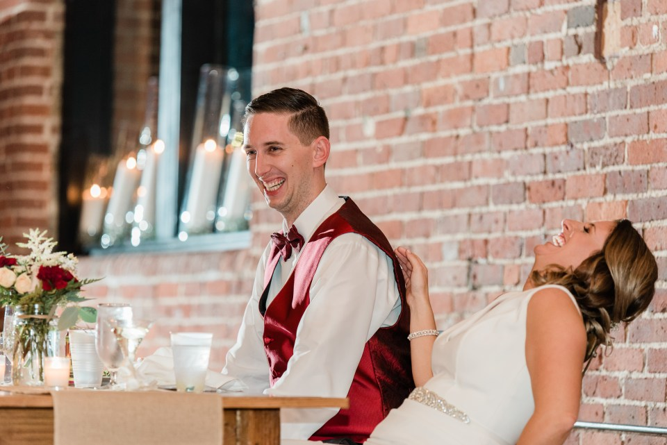 Reactions to a wedding toast at Charles river museum wedding in Waltham MA