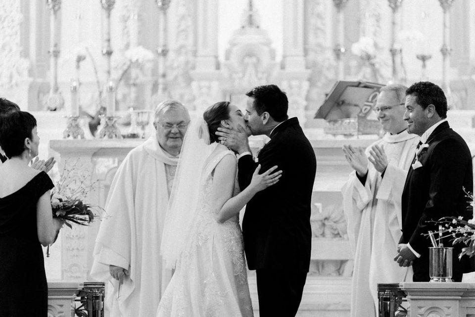 Bride and Groom first kiss St Edward's church Palm Beach