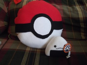 Pokeball pillow and a little plush rice ball!
