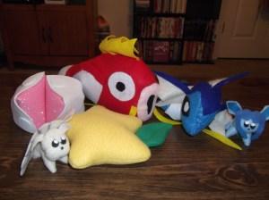 Plushies: Ninetails, pink glittery Chii Chobits ears, Pakyu fruit from Kingdom Hearts, Magikarp, Vaperon, and Glacion. ^_^
