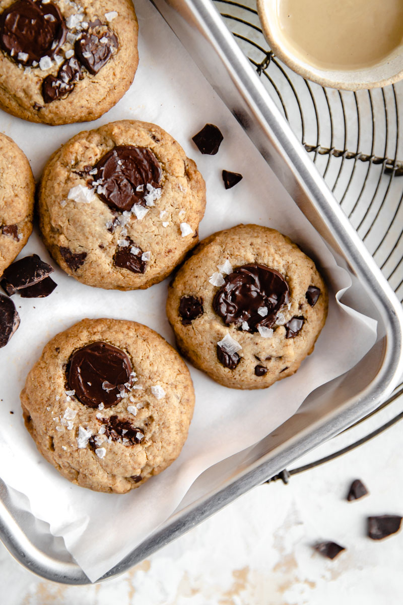 These vegan & paleo tahini chocolate chip cookies need only one bowl with just a few gluten free ingredients.  They're so thick and chewy you won't believe they're egg-free, nut-free, dairy-free, gluten-free, paleo, and plant-based!