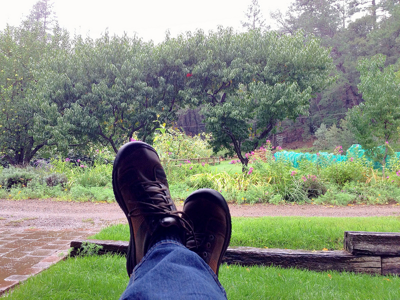 Feet up, enjoying the view and the rain