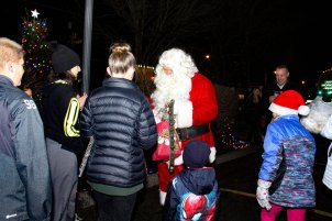 Santa hands out candy at 2018 Moriches Chamber tree lighting