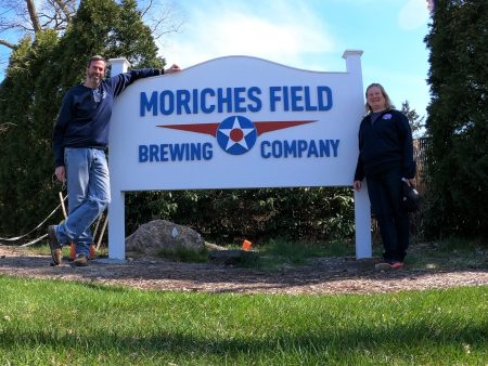 Finished corner sign with the Moriches Field Brewing Company logo and owners.