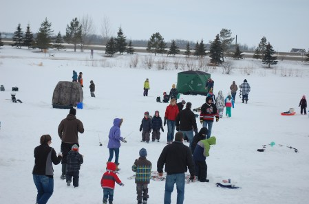 Family Day Fun - Frank Koenig sent us these two shots from the Bob Foster Memorial Fishing Derby that took place over the Family Day weekend. The first is he crowd that came out for the event. The second is the bonfire that t folks warm.