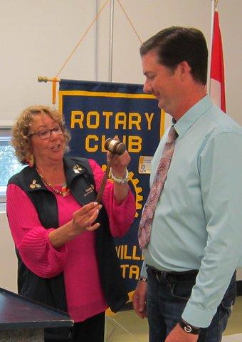 Rotary Pres Linda Kilian passes gavel to President Elect Brian Reed