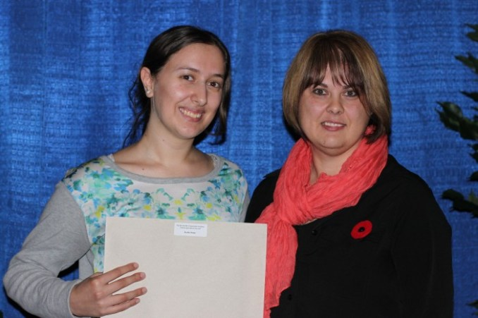Val Loseth presented a Morinville Community Gardens Urban Ag Award to Hadla Omar.
