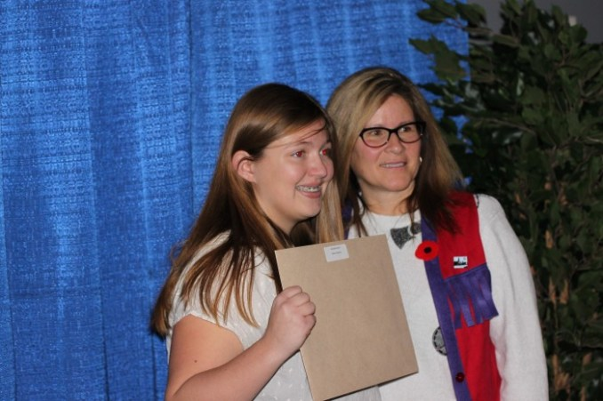 Lions Club member Deborah Robillard presented Rebecca Kerrison with the Peter Gibeault Lion Quest Award, presented to a Grade 10 or 11 student for community volunteerism.