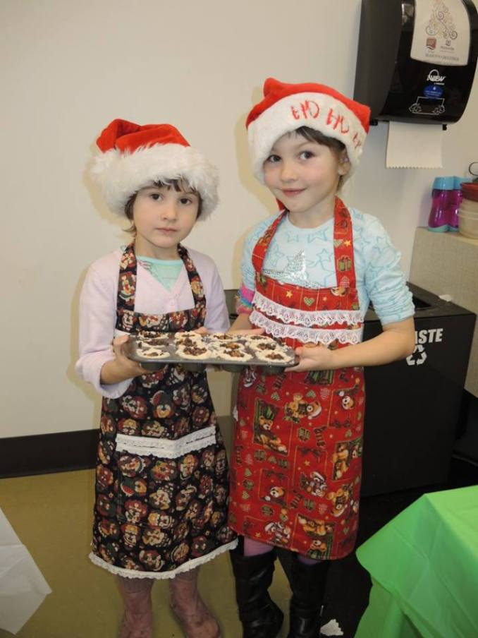 Christmas bakers Emma and Addison Berry just finished making some chocolate toffee shortbread cups when they posed for this festive photo.