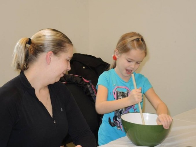 Melissa and McKenna Meade starting on the sugar cookie dough.