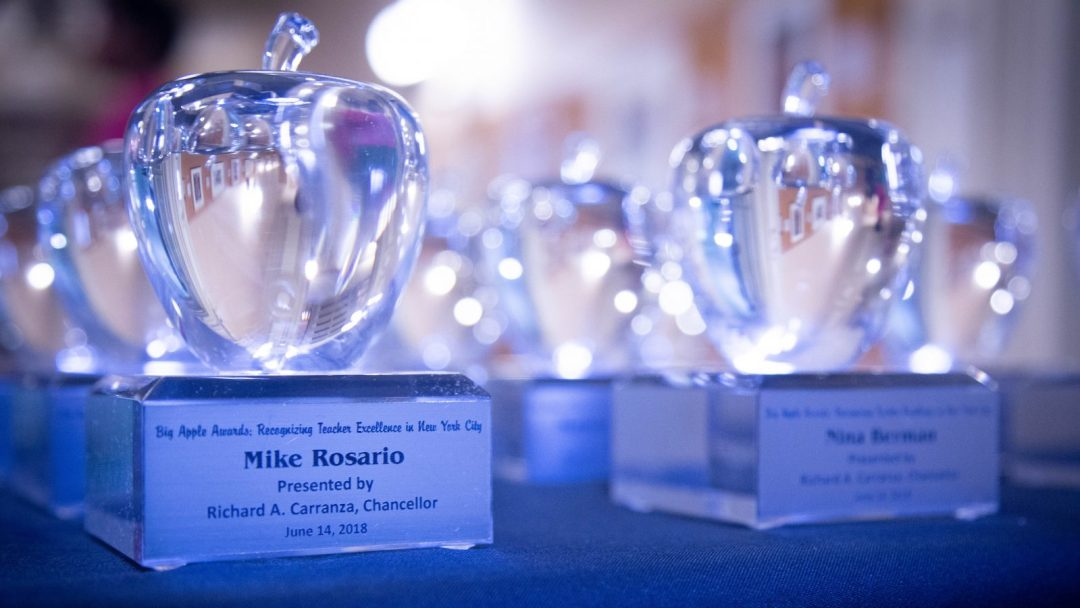 Close-up of the DOE's Big Apple Award statues