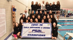 Entire Stuyvesant Girls swimming team posing for a photo as they hold up their 2018–19 PSAL Girls Swimming & Diving Championship banner.