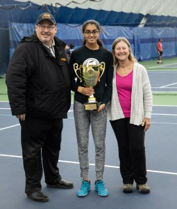 Staten Island Tech student, Miriam Aziz (middle) holds PSAL Girls Singles trophy alongside a PSAL official and her coach