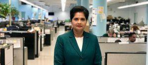 Sunita Mahabir facing camera in the middle of her Long Island City office
