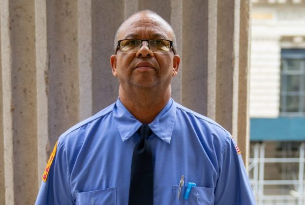 School Bus Driver, Fred Sinclair, standing outside Tweed Courthouse in Manhattan