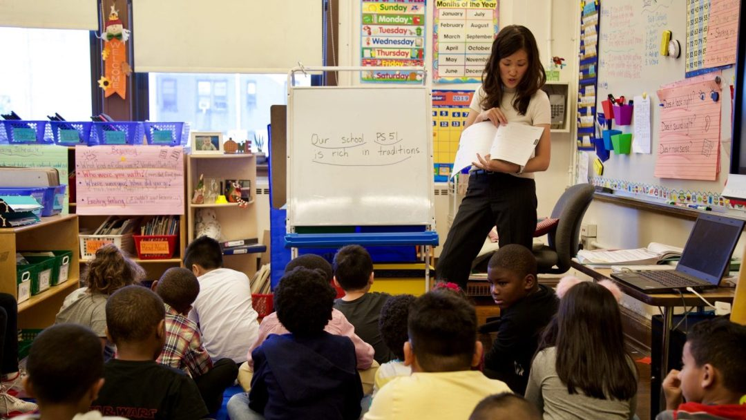 Literacy Coach Annie Kim Sounding Out Words to Class