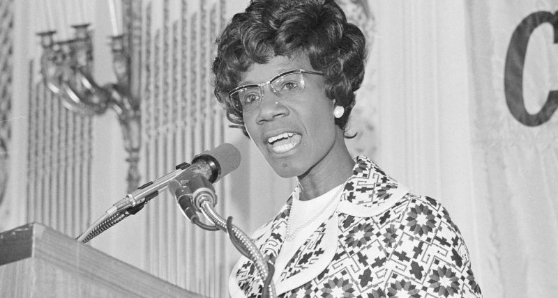 Shirley Chisholm giving a speech at a podium