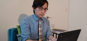 Zuobin Tang working with his student online