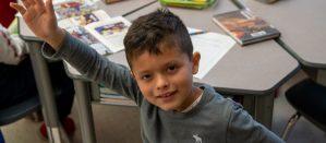 Second grader student raising hand