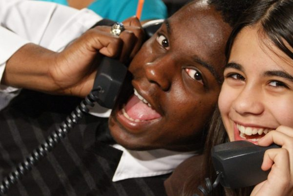 Two students answering phones during a phone bank