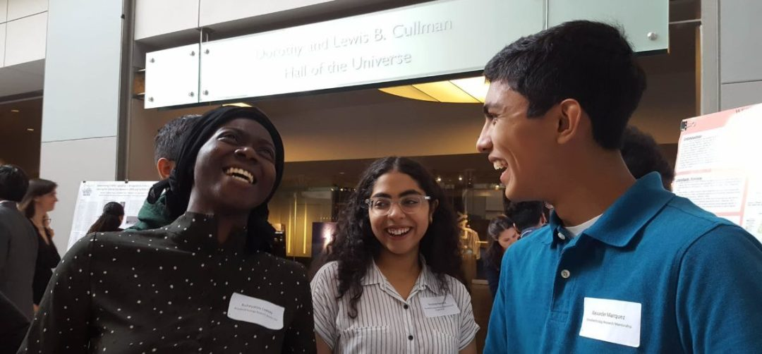 Three students talking and laughing