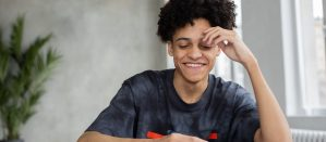 Student smiling while looking over school work