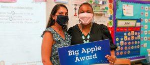 Chancellor Meisha Porter (right) standing next to BAA 2021 award-winner, Mel Bolano