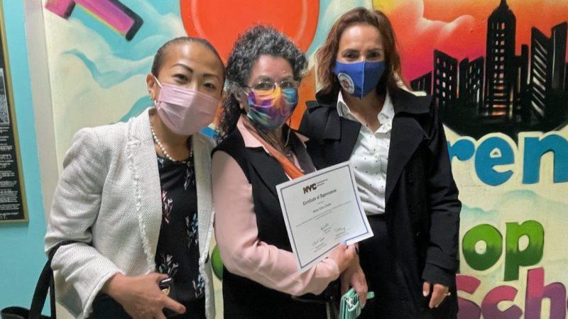 Marisol Rosales (right) standing with Maria Velez Clarke (center) of the Children's Workshop School