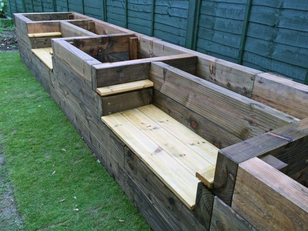 would you like to add raised garden beds to your yard while also adding some extra sitting space if so this design is for you - Raised Garden Bed Design Ideas
