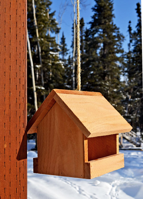 This little birdfeeder follows a traditional design. But it is made out of  beautiful cedar