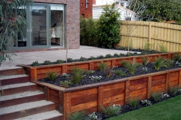 this retaining wall is a great option for deck railing instead of doing the traditional posts with the spindles in between you could build this beautiful - Deck Railing Design Ideas