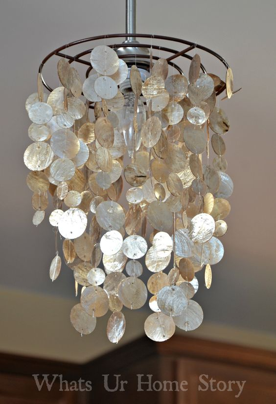 34 beautiful diy chandelier ideas that will light up your home diy capiz chandelier aloadofball Images