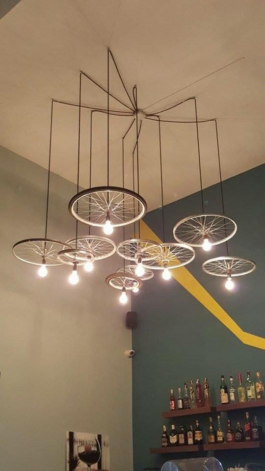 34 beautiful diy chandelier ideas that will light up your home the bicycle chandelier aloadofball Choice Image