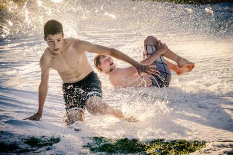Teens slip and slide