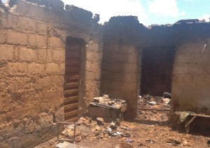 Charred home of the slain Gideon Mutang Kidum. (Morning Star News)