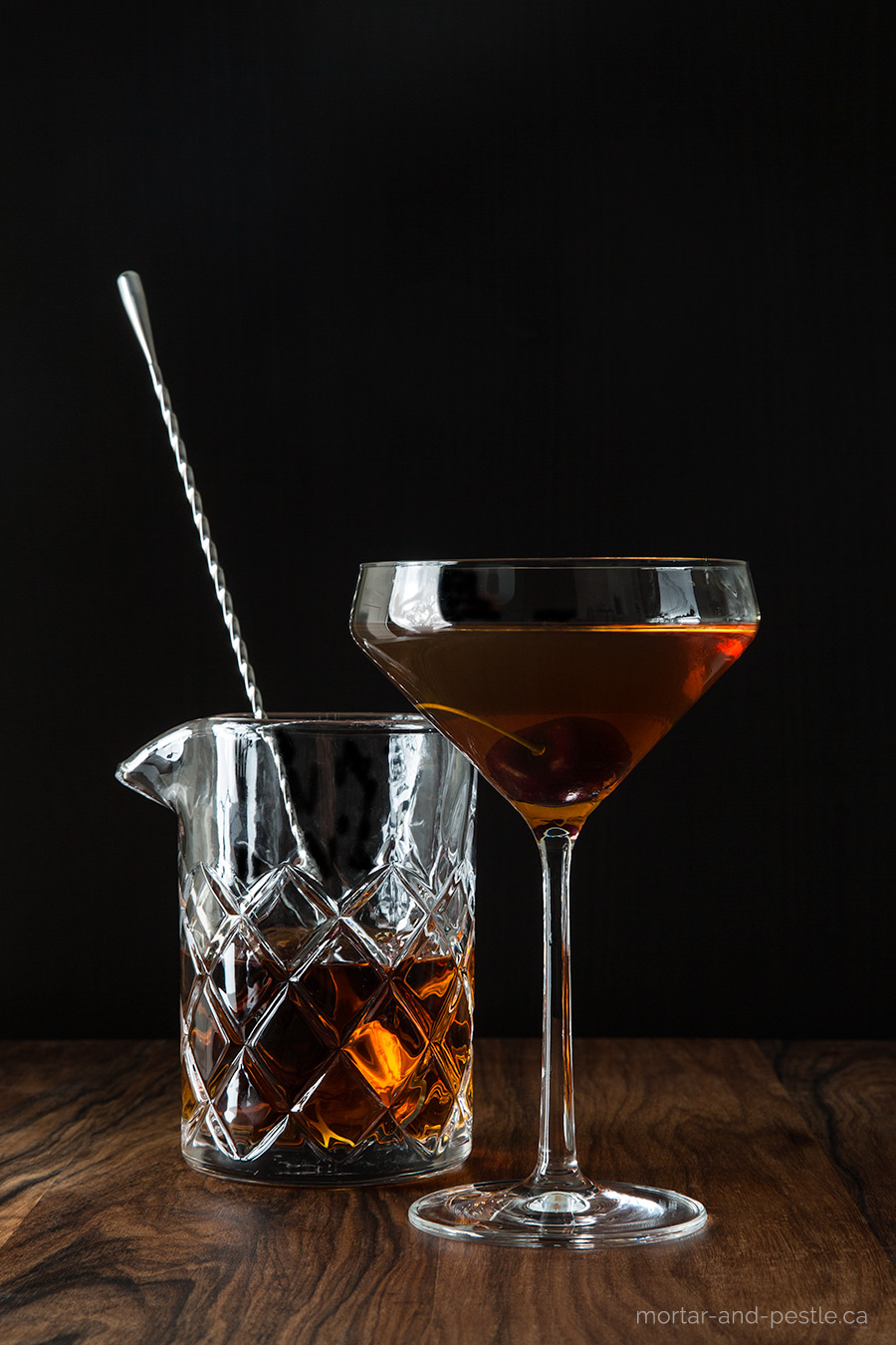 A Mexican ancho chile liqueur and home-made cocktail cherries put a spicy, smoky spin on the classic Manhattan.