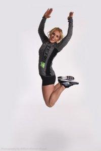 Cassie Kociemba jumps for joy (on white seamless)
