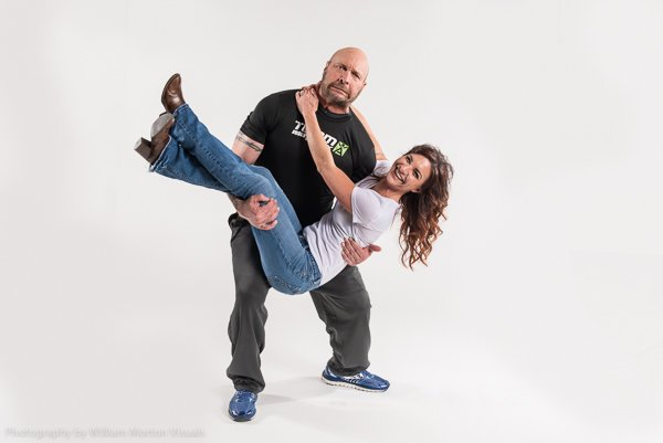Tony Mandarich shows a little humor with his girlfriend on a white seamless background