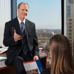 Senior VP and Regional Manager Bob Jondall discusses commercial banking with a client in San Diego